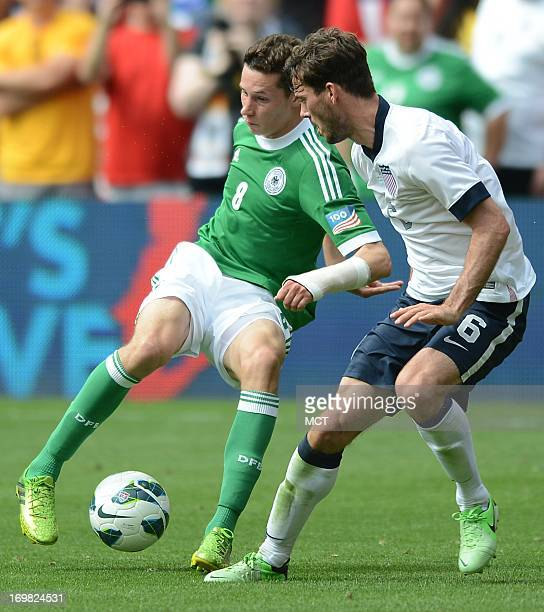 Germany midfielder Julian Draxler works the ball against USA midfielder Brad Evans in the second half of an international friendly at RFK Stadium in...