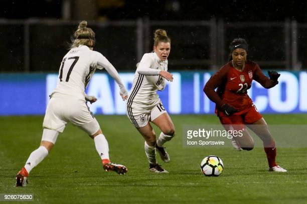 Germany midfielder Linda Dallmann and United States defender Taylor Smith sprint after the ball during the second half of the international game...