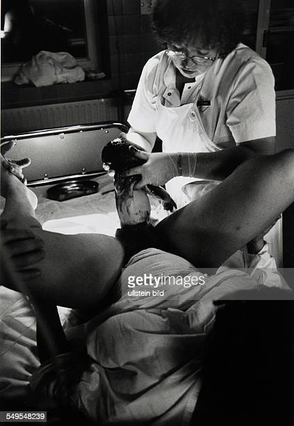 Germany midwife assisting a mother giving birth in a Hamburg hospital