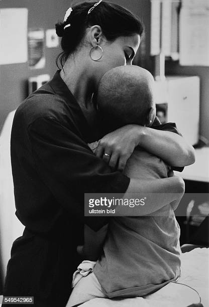 Germany mother with her son who suffers from cancer in a hospital after chemotherapy