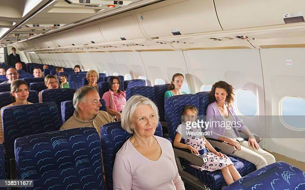 Germany, Munich, Bavaria, People in economy class airliner