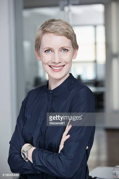Germany, Munich, Businesswoman in office