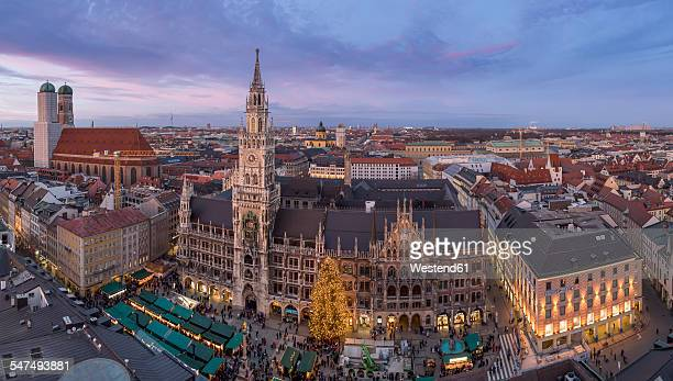 germany, munich, christmas market at townhall square in the evening - new town hall munich stock pictures, royalty-free photos & images