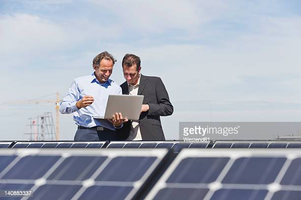 Germany, Munich, Engineer with man in solar plant