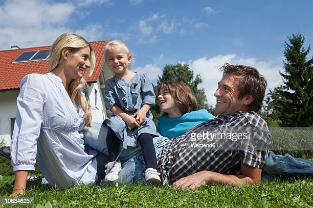 Germany, Munich, Family in garden, smiling