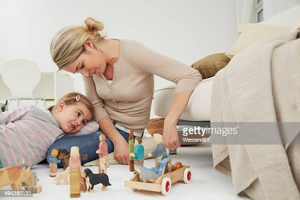 Germany, Munich, Mother playing with daughter
