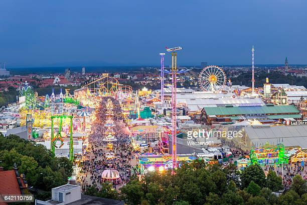 germany, munich, oktoberfest overview at twilight - theresienwiese stock pictures, royalty-free photos & images