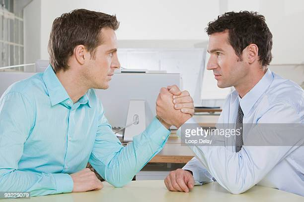 Germany, Munich, Two business men arm wrestling, close-up, side view