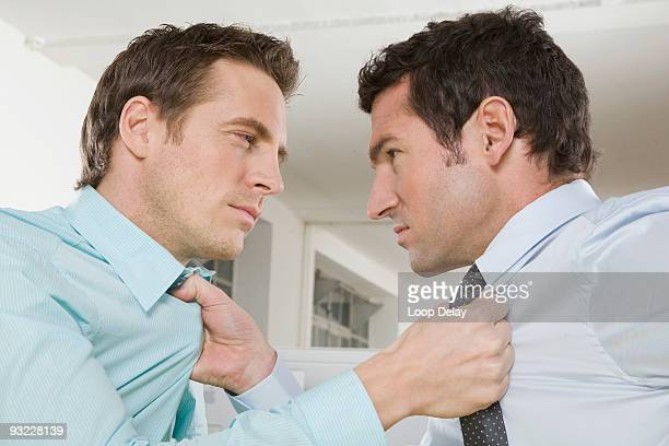 germany, munich, two business men fighting in office, close-up - diverbio foto e immagini stock