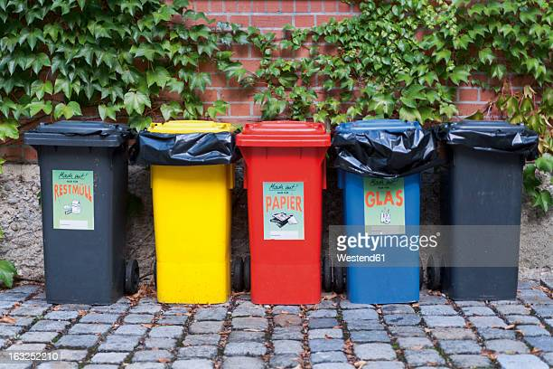 germany, munich, various garbage containers in yard - garbage can stock photos and pictures