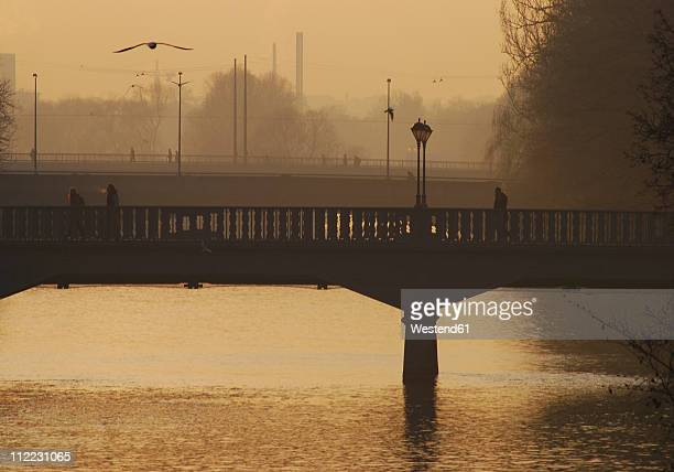 Germany, Munich, View of bridge over river isar at sunset