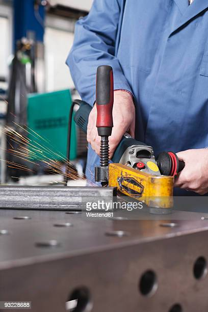 Germany, Neukirch, Person using grinder