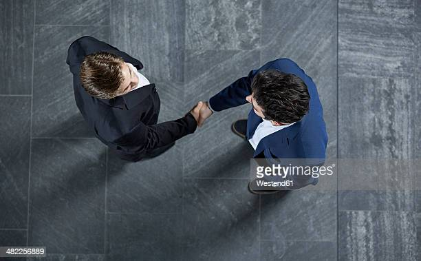 Germany, Neuss, Business men shaking hands