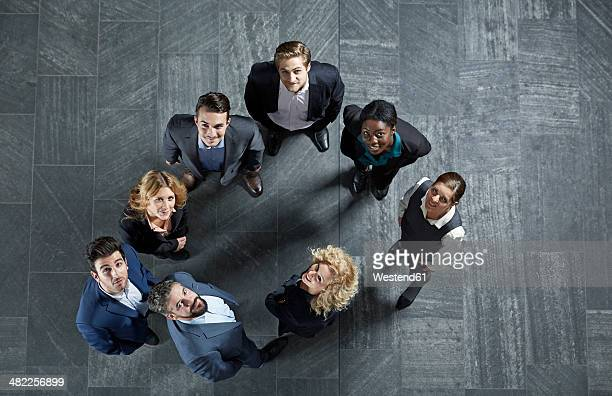 Germany, Neuss, Business people standing on floor, looking up
