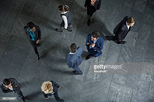 Germany, Neuss, Business people standing on floor
