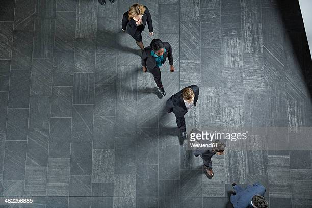 Germany, Neuss, Business people walking in a row