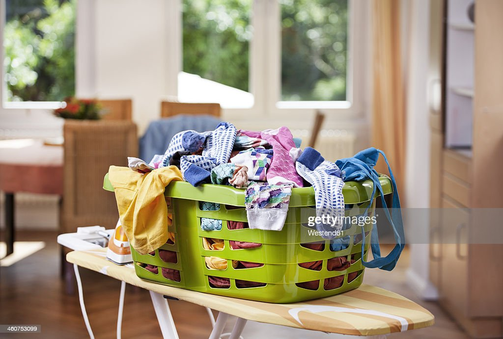 Germany, North Rhine Westphalia, Cologne, Clothes in laundry basket : Stock Photo