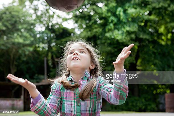 Germany, North Rhine Westphalia, Cologne, Girl playing in playground, smiling
