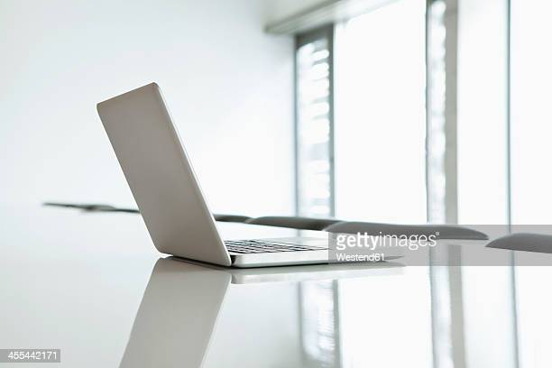 Germany, North Rhine Westphalia, Cologne, Laptop on conference table