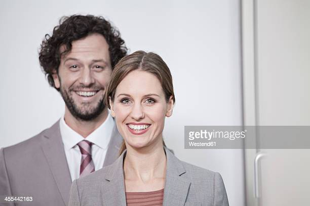 Germany, North Rhine Westphalia, Cologne, Portrait of businesscouple, smiling