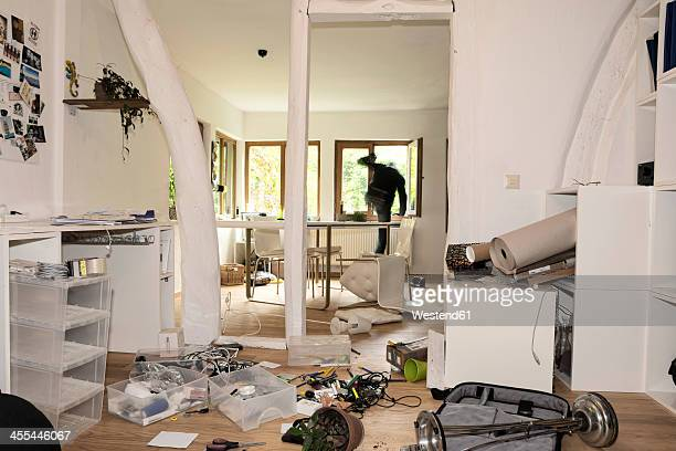 germany, north rhine westphalia, mature man running through window - thief stock pictures, royalty-free photos & images