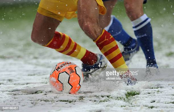 Germany North RhineWestphalia Bochum football battling for the ball on a snowcovered pitch