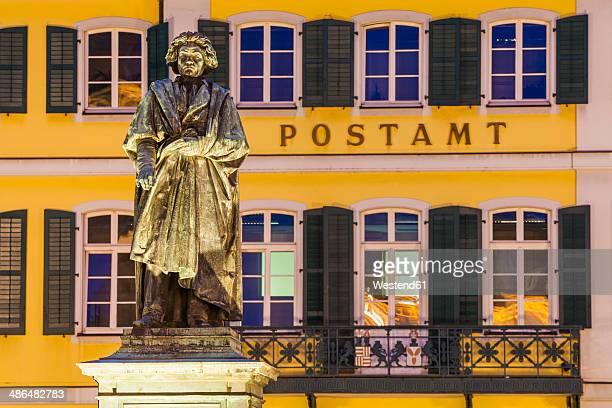 Germany, North Rhine-Westphalia, Bonn, lighted Memorial to Beethoven at Muensterplatz by evening twilight
