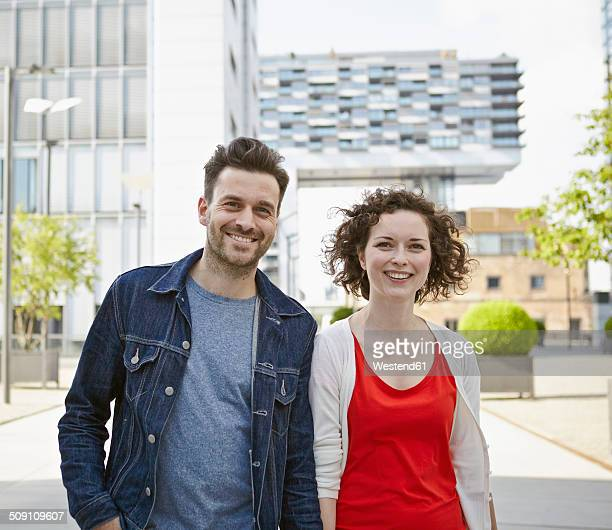 Germany, North Rhine-Westphalia, Cologne, couple on the move at Rheinauhafen