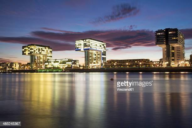 Germany, North Rhine-Westphalia, Cologne, Crane houses at Rheinau harbour at dusk