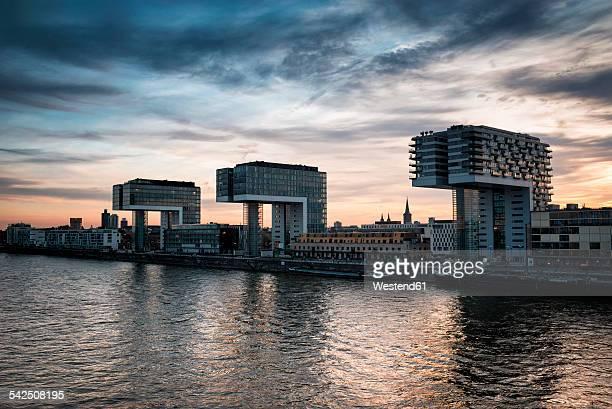 Germany, North Rhine-Westphalia, Cologne, view to Crane Houses at Rheinau Harbour at twilight