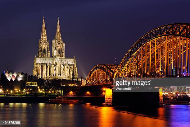 Germany, North Rhine-Westphalia, Cologne, view to lighted Hohenzollern Bridge and Cologne Cathedral by night