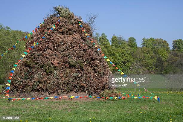 Germany, North Rhine-Westphalia, Detmold, Woodpile for easter fire, decorated with pennants