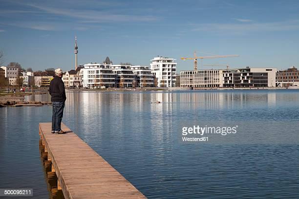 germany, north rhine-westphalia, dortmund-hoerde, lake phoenix, senior standing on wooden boardwalk - dortmund city stock pictures, royalty-free photos & images