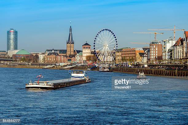 Germany, North Rhine-Westphalia, Duesseldorf, view to old town with Rhine River in the foreground