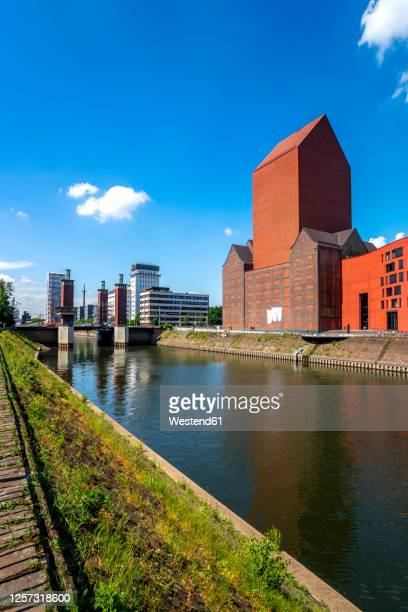 germany, north rhine-westphalia, duisburg, canal in front of nrw state archive department rheinland - north rhine westphalia stock pictures, royalty-free photos & images