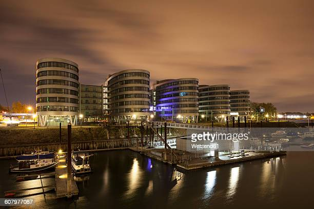Germany, North Rhine-Westphalia, Duisburg, Inner harbour and office buildings at night