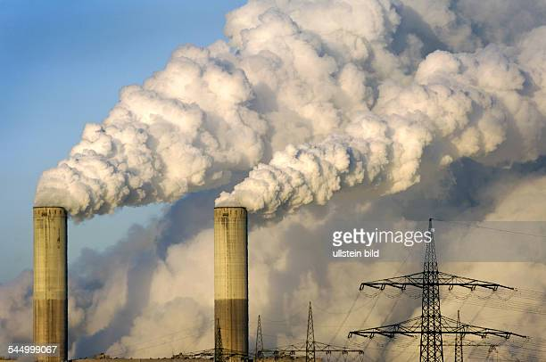 Germany North RhineWestphalia Frimmersdorf the power plant Frimmersdorf of RWE AG| exhaust fumes and steam rises from the chimneys