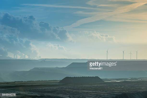 germany, north rhine-westphalia, garzweiler surface mine, brown coal power station and wind turbines in background - north rhine westphalia stock pictures, royalty-free photos & images