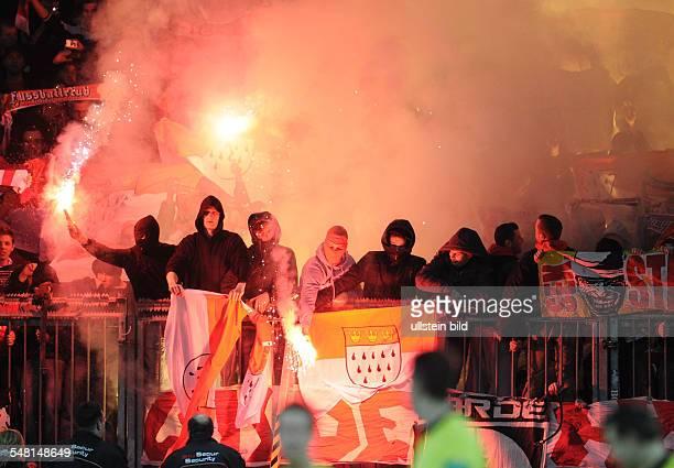 Germany North RhineWestphalia Leverkusen Bundesliga season 20092010 matchday 24 Bayer 04 Leverkusen v 1 FC Koeln 00 Cologne supporters lighting flares