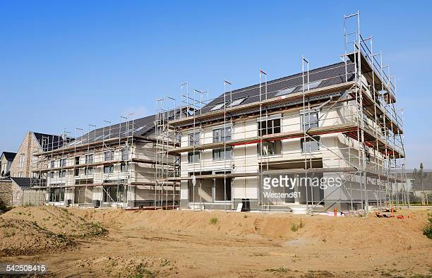 Germany, North Rhine-Westphalia, Neuss, view to construction site of two semidetached houses