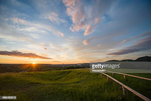Germany, North Rhine-Westphalia, View from Rodderberg to Bonn at sunset