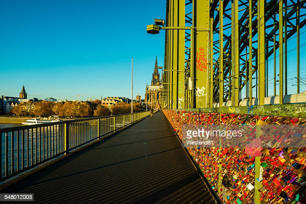 germany, north rine-westphalia, cologne, love locks at hohenzollernn bridge - north rhine westphalia stock pictures, royalty-free photos & images