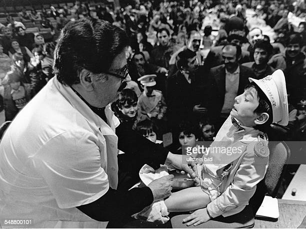 Germany NorthRhineWestfalia Huerth local anaesthetic is given to a Turkish boy during a big festival of circumcision 1982