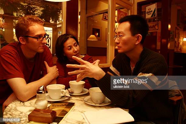 JanWelf Selke a student from Cologne is sitting with his girlfriend Martha Lucia Clavijo Welasco and Yunpeng Zang in a students cafe in the city Both...