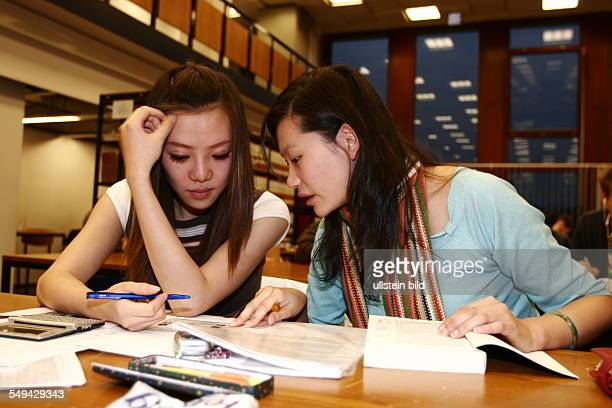 Zhan Zhang left side who came to Aachen for a German course and Na Sun who studies economic engineering are learning together in the library Both...