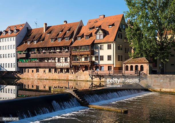 Germany, Nuremberg, row of houses at Pegnitz River with Naegelein weir