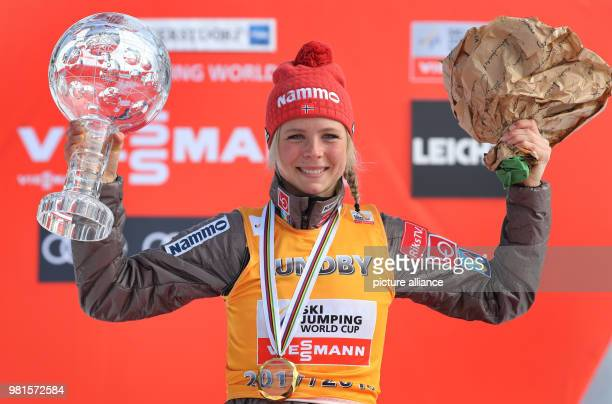 Weltcup 25 March 2018 Germany Bavaria World Cup Ski Jumping Women Maren Lundby from Norway celebrates during the awards ceremony after winning the...