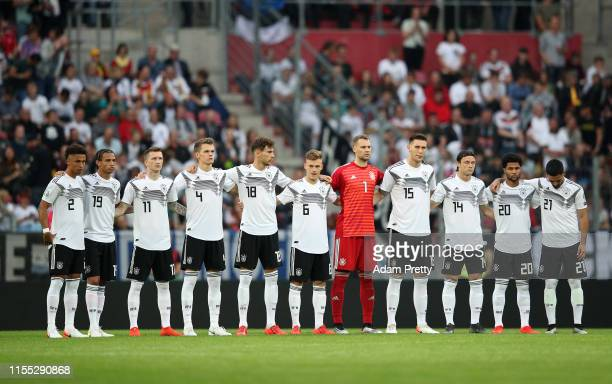Germany observe a minute's silence prior to the UEFA Euro 2020 Qualifier match between Germany and Estonia at Opel Arena on June 11, 2019 in Mainz,...