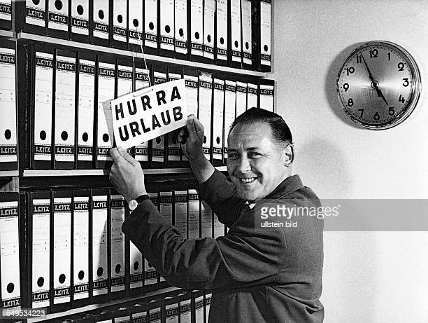 Germany office clerk starting into vacastion in the 1960's
