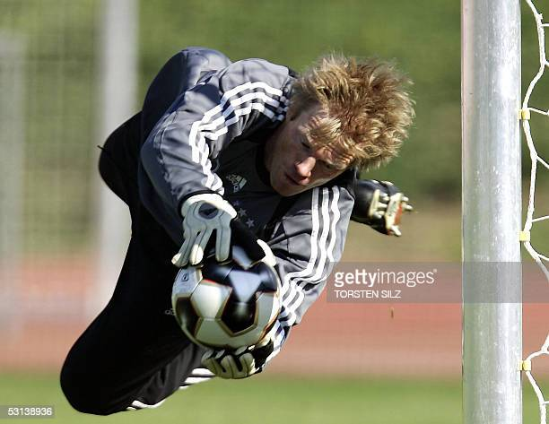 Oliver Kahn goalkeeper of the German national football team dives for a ball during a training session 23 June 2005 in Herzogenaurach southern...